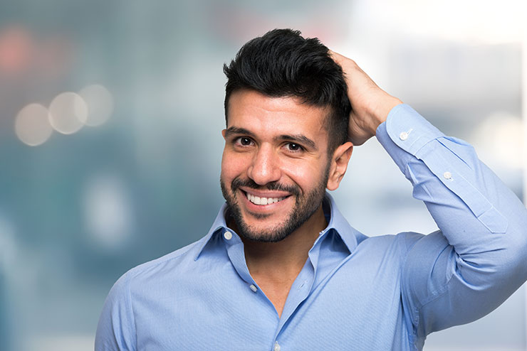 man holding hair scalp care